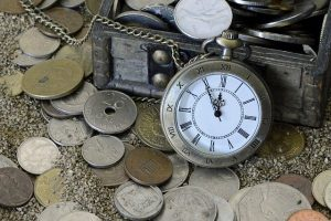 A pocket watch and the box of coins.
