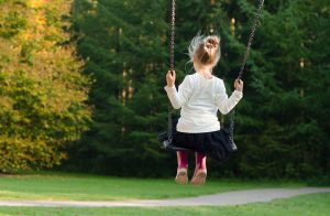 A child on a swing.