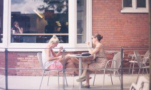 Two girls talking.