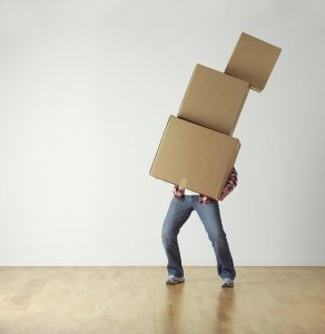 A man carrying boxes.