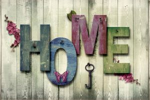 The word home written in large wooden letters in various colors.