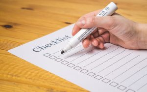 A person completing a checklist.