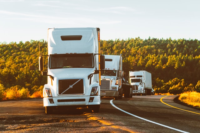 A row of trucks for a cross country move