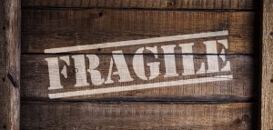 A fragile sign on a wooden crate.