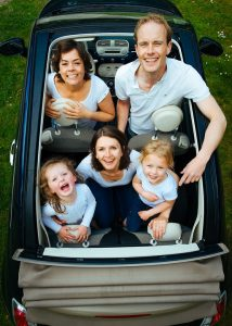 A family in the car after creating a Florida to Virginia road trip map.