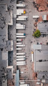 an image of an areal view of truck in front of a gray building